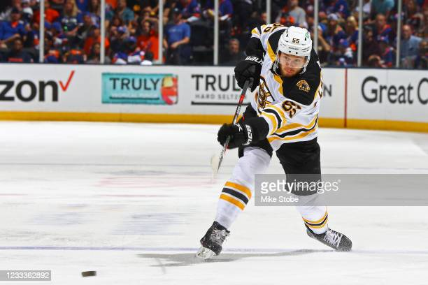 Jeremy Lauzon of the Boston Bruins attempts a shot against the New York Islanders during the second period in Game Six of the Second Round of the...