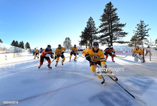 Jeremy Lauzon of the Boston Bruins controls the puck against the Philadelphia Flyers during the first period of the 2021 NHL Outdoors Sunday...