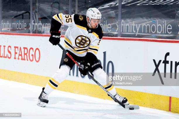 Jeremy Lauzon of the Boston Bruins controls the puck during the third period against the Philadelphia Flyers at Wells Fargo Center on February 05,...