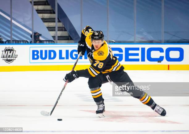 Jeremy Lauzon of the Boston Bruins plays the puck against the Carolina Hurricanes during the first period in Game One of the Eastern Conference First...