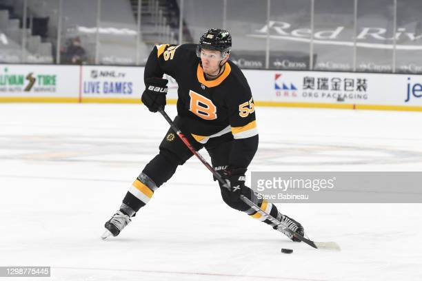 Jeremy Lauzon of the Boston Bruins shoots the puck against the Pittsburgh Penguins at the TD Garden on January 26, 2021 in Boston, Massachusetts.
