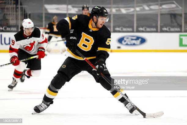 Jeremy Lauzon of the Boston Bruins skates against the New Jersey Devils during the third period at TD Garden on February 18, 2021 in Boston,...