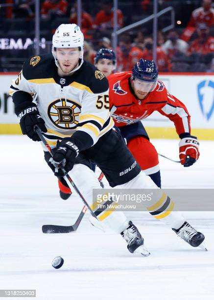 Jeremy Lauzon of the Boston Bruins skates with the puck during the first period against the Washington Capitals during Game One of the First Round of...