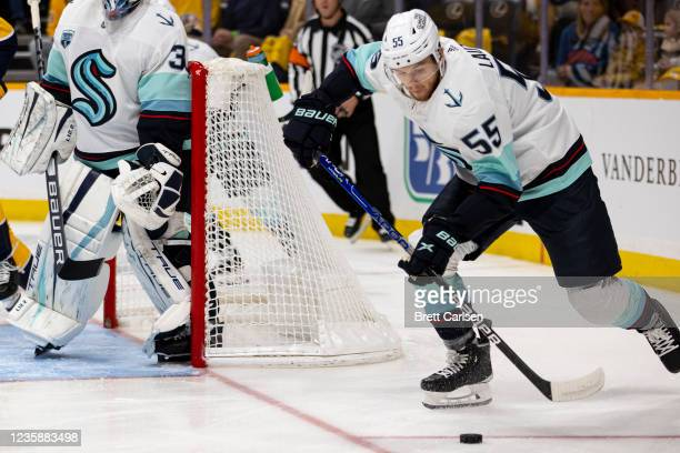 Jeremy Lauzon of the Seattle Kraken skates the puck from behind his net against the Nashville Predators in the first period at Bridgestone Arena on...