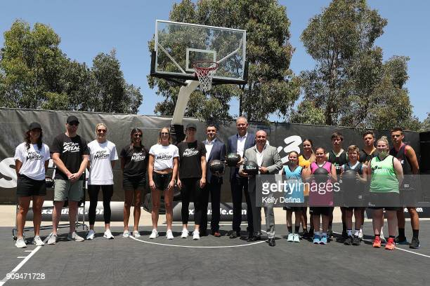 Jeremy Leoliger Larry Kestelman and Ned Coten pose with NBL/ WNBL/ youth players at a NBL media opportunity at Federation Square on January 24 2018...
