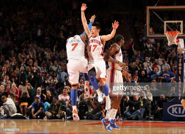 Jeremy Lin and Carmelo Anthony of the New York Knicks react to the game action during the fourth quarter against the Toronto Raptors on March 20,...