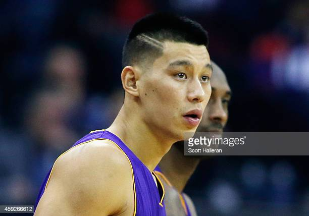 Jeremy Lin and Kobe Bryant of the Los Angeles Lakers wait to enter the game during their game against the Houston Rockets at the Toyota Center on...