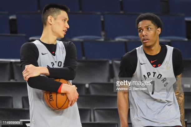 Jeremy Lin and Patrick McCaw of the Toronto Raptors talk during NBA Finals practice and media availability on June12 2019 at Oracle Arena in Oakland...