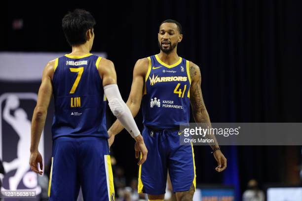 Jeremy Lin high-fives Ryan Taylor of the Santa Cruz Warriors during the game on March 6, 2021 at HP Field House in Orlando, Florida. NOTE TO USER:...
