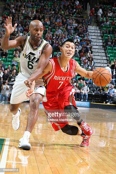 Jeremy Lin of of the Houston Rockets drives to the basket against Jamaal Tinsley of the Utah Jazz at EnergySolutions Arena on November 02 2013 in...