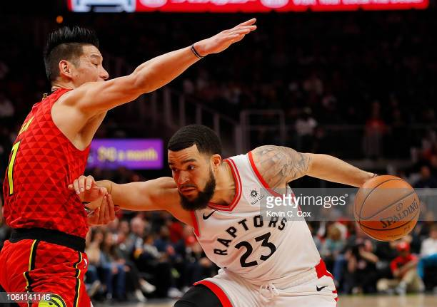 Jeremy Lin of the Atlanta Hawks draws an offensive foul from Fred VanVleet of the Toronto Raptors at State Farm Arena on November 21 2018 in Atlanta...