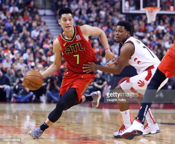 Jeremy Lin of the Atlanta Hawks dribbles the ball as Kyle Lowry of the Toronto Raptors defends during the first half of an NBA game at Scotiabank...