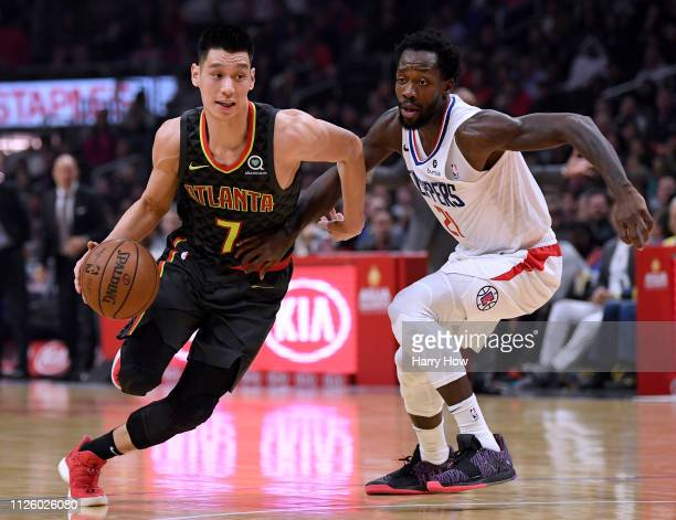 Jeremy Lin of the Atlanta Hawks drives past Patrick Beverley of the LA Clippers during a 123-118 Hawks win at Staples Center on January 28, 2019 in...