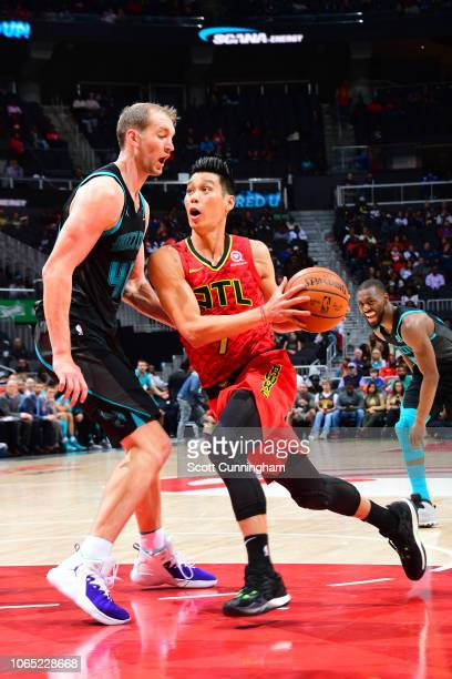 Jeremy Lin of the Atlanta Hawks drives to the basket against Cody Zeller of the Charlotte Hornets on November 25 2018 at State Farm Arena in Atlanta...