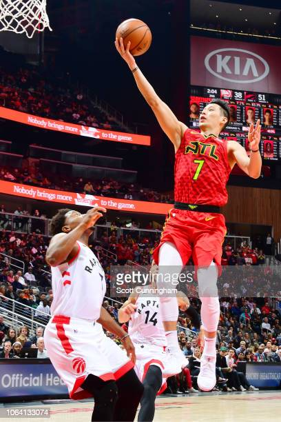 Jeremy Lin of the Atlanta Hawks drives to the basket during the game against Serge Ibaka of the Toronto Raptors on November 21 2018 at the State Farm...