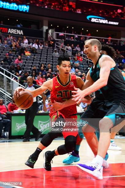 Jeremy Lin of the Atlanta Hawks handles the ball against the Charlotte Hornets on November 25 2018 at State Farm Arena in Atlanta Georgia NOTE TO...