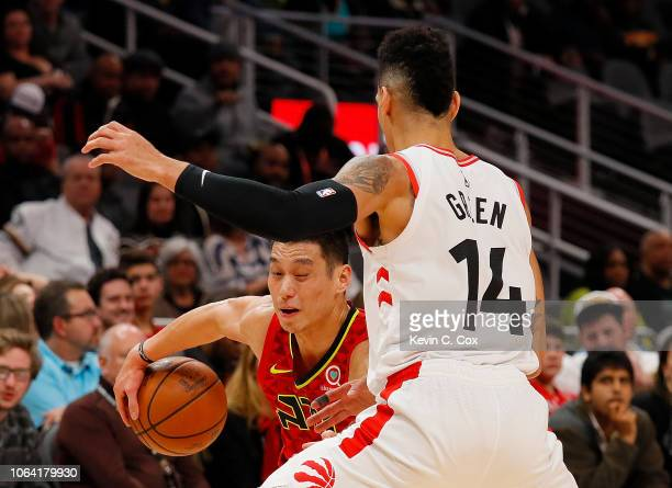 Jeremy Lin of the Atlanta Hawks looks to drive against Danny Green of the Toronto Raptors at State Farm Arena on November 21 2018 in Atlanta Georgia...