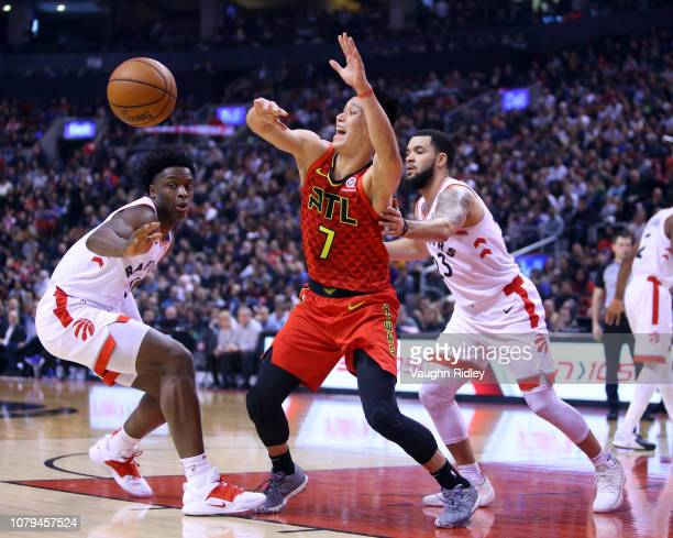 Jeremy Lin of the Atlanta Hawks loses the ball as OG Anunoby and Fred VanVleet of the Toronto Raptors defend during the first half of an NBA game at...