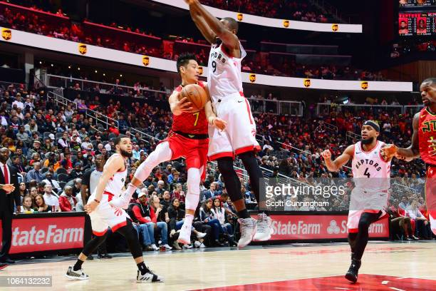 Jeremy Lin of the Atlanta Hawks passes the ball during the game against Serge Ibaka of the Toronto Raptors on November 21 2018 at the State Farm...