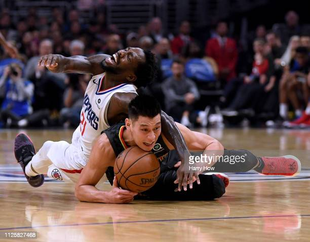 Jeremy Lin of the Atlanta Hawks protects the ball from Patrick Beverley of the LA Clippers as he falls during a 123-118 Hawks win at Staples Center...