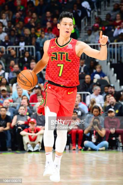 Jeremy Lin of the Atlanta Hawks signals a pass during the game against the Toronto Raptors on November 21 2018 at the State Farm Arena in Atlanta...