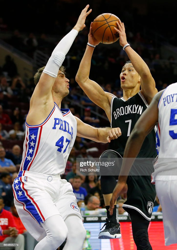 Jeremy Lin #7 of the Brooklyn Nets attempts a shot as Tiago Splitter #47 of the Philadelphia 76ers defends in the first half during an NBA game at Wells Fargo Center on April 4, 2017 in Philadelphia, Pennsylvania. The Nets defeated 76ers 141-118.