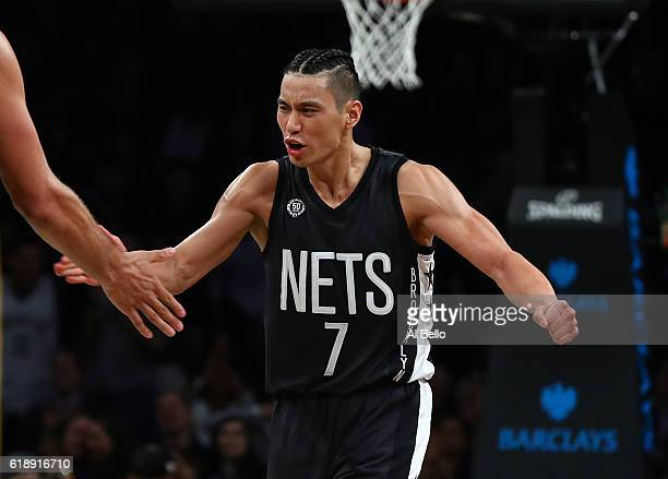 Jeremy Lin of the Brooklyn Nets celebrates against the Indiana Pacers during their game at the Barclays Center on October 28 2016 in New York City...
