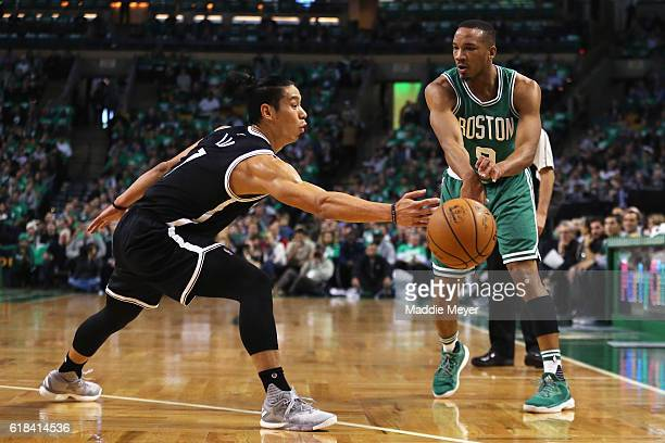 Jeremy Lin of the Brooklyn Nets defends Avery Bradley of the Boston Celtics during the first quarter at TD Garden on October 26 2016 in Boston...