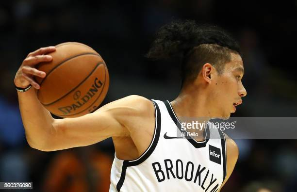 Jeremy Lin of the Brooklyn Nets dribbles against the Philadelphia 76ers during their Pre Season game at Nassau Veterans Memorial Coliseum on October...