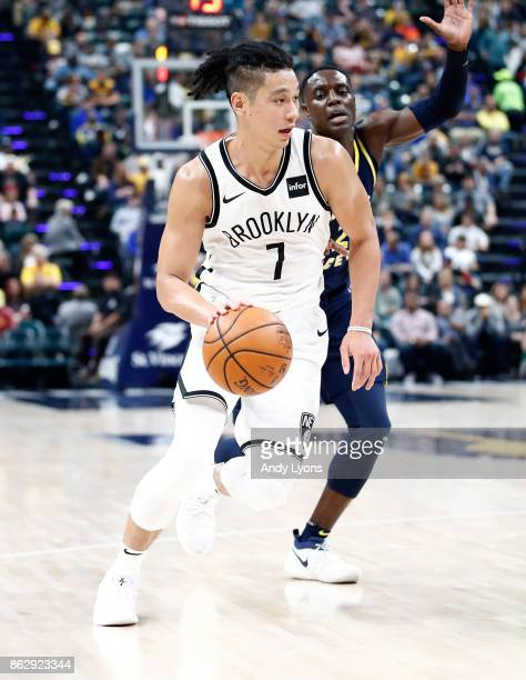 Jeremy Lin of the Brooklyn Nets dribbles the ball against the Indiana Pacers at Bankers Life Fieldhouse on October 18 2017 in Indianapolis Indiana...