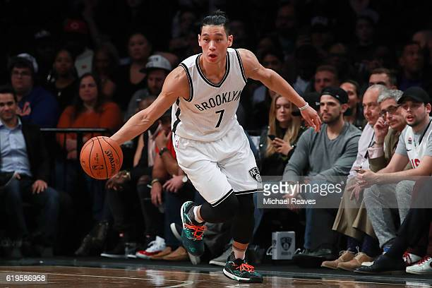 Jeremy Lin of the Brooklyn Nets dribbles up court against the Chicago Bulls during the first half at Barclays Center on October 31 2016 in New York...