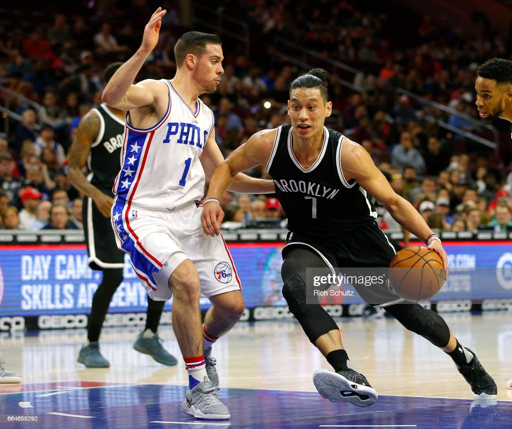 Jeremy Lin #7 of the Brooklyn Nets drives to the basket as T.J. McConnell #1 of the Philadelphia 76ers defends in the first half during an NBA game at Wells Fargo Center on April 4, 2017 in Philadelphia, Pennsylvania. The Nets defeated 76ers 141-118.