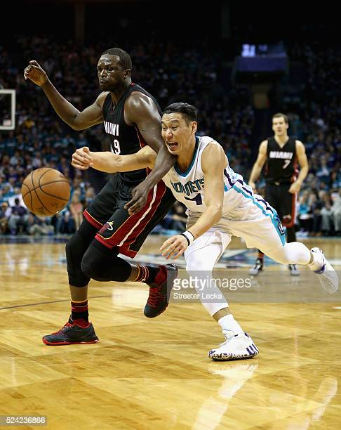 Jeremy Lin of the Charlotte Hornets goes after a loose ball against Luol Deng of the Miami Heat during game four of the Eastern Conference...