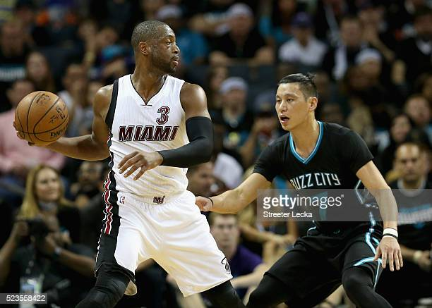 Jeremy Lin of the Charlotte Hornets guards Dwyane Wade of the Miami Heat during game three of the Eastern Conference Quarterfinals of the 2016 NBA...