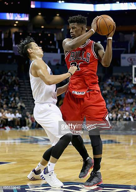 Jeremy Lin of the Charlotte Hornets guards Jimmy Butler of the Chicago Bulls during their game at Time Warner Cable Arena on November 3 2015 in...