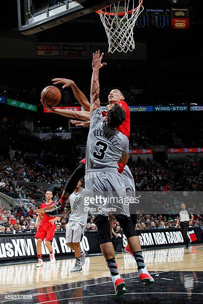 Jeremy Lin of the Houston Rockets attempts a shot against Marco Belinelli of the San Antonio Spurs on December 25 2013 at the ATT Center in San...