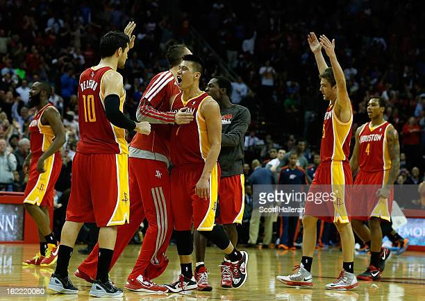 Jeremy Lin of the Houston Rockets celebrates a three point shot with his teammates during the game against the Oklahoma City Thunder at Toyota Center...