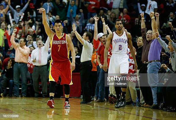Jeremy Lin of the Houston Rockets celebrates after a basket as Thabo Sefolosha of the Oklahoma City Thunder looks on at Toyota Center on February 20...