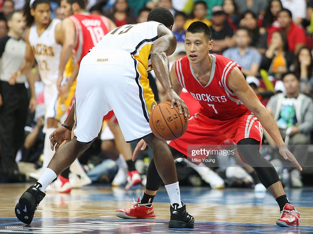 Jeremy Lin #7 of the Houston Rockets defends against Donald Sloan #15 of the Indiana Pacers during the NBA game at the Mall of Asia Arena on October 10, 2013 in Manila, Philippines.
