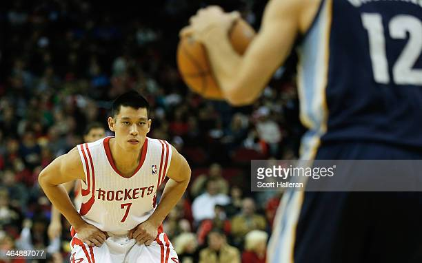 Jeremy Lin of the Houston Rockets defends against Nick Calathes of the Memphis Grizzlies during the game at the Toyota Center on January 24 2014 in...