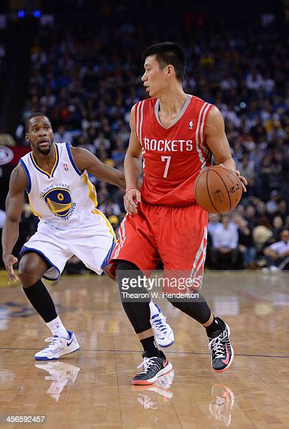 Jeremy Lin of the Houston Rockets dribbles the ball defended by Toney Douglas of the Golden State Warriors at ORACLE Arena on December 13 2013 in...