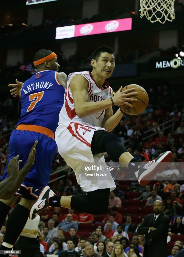 Jeremy Lin #7 of the Houston Rockets drives past Carmelo Anthony #7 of the New York Knicks at the Toyota Center on November 23, 2012 in Houston, Texas.