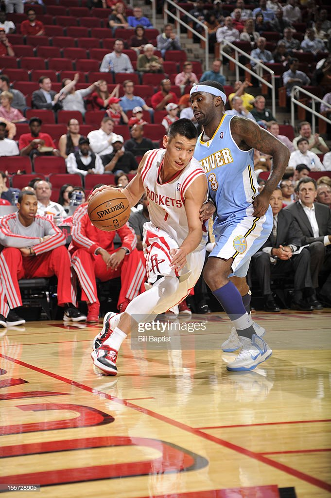 Jeremy Lin #7 of the Houston Rockets drives the ball against Ty Lawson #3 of the Denver Nuggets on November 7, 2012 at the Toyota Center in Houston, Texas.