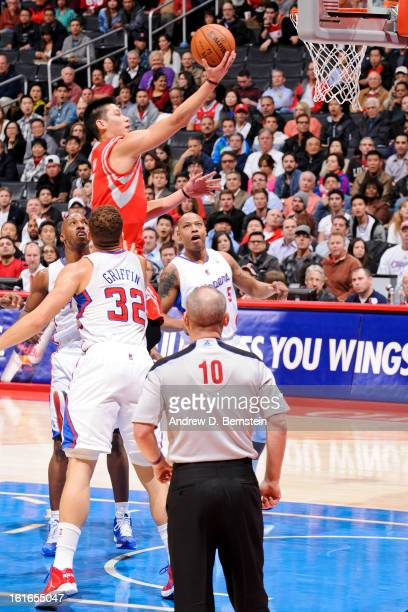 Jeremy Lin of the Houston Rockets drives to the basket against Blake Griffin Chauncey Billups and Caron Butler of the Los Angeles Clippers at Staples...