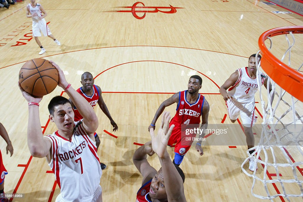 Jeremy Lin #7 of the Houston Rockets drives to the basket against the Philadelphia 76ers on December 19, 2012 at the Toyota Center in Houston, Texas.