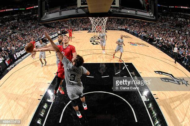 Jeremy Lin of the Houston Rockets drives to the basket against the San Antonio Spurs during the game at the ATT Center on December 25 2013 in San...
