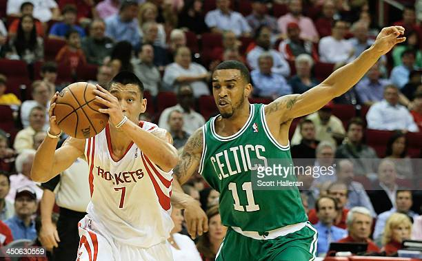Jeremy Lin of the Houston Rockets drives with the ball past Courtney Lee of the Boston Celtics at the Toyota Center on November 19 2013 in Houston...