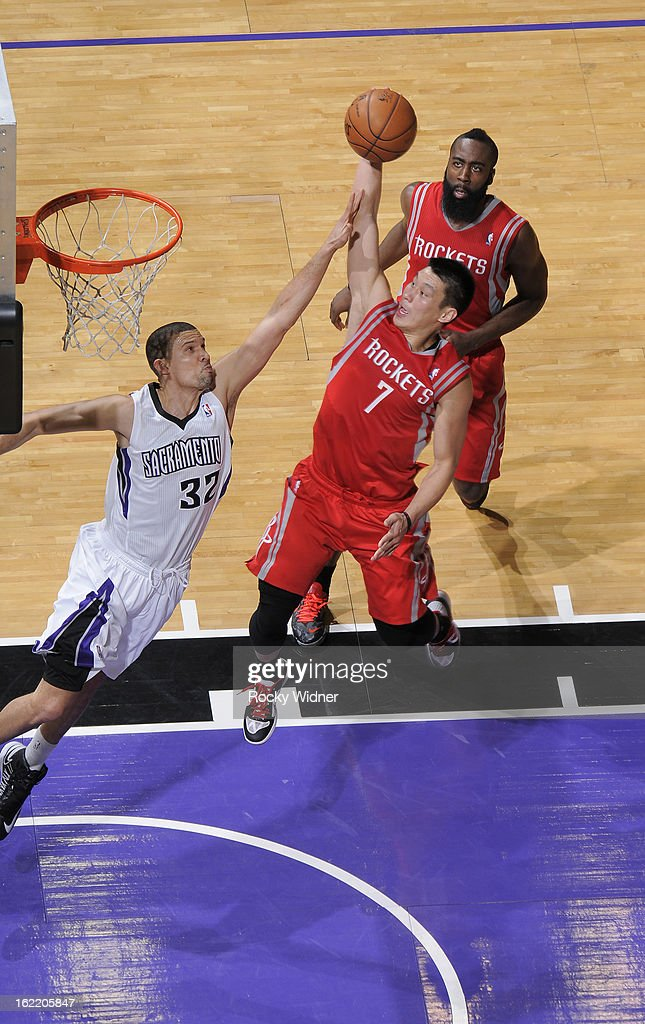 Jeremy Lin #7 of the Houston Rockets dunks against Francisco Garcia #32 of the Sacramento Kings on February 10, 2013 at Sleep Train Arena in Sacramento, California.