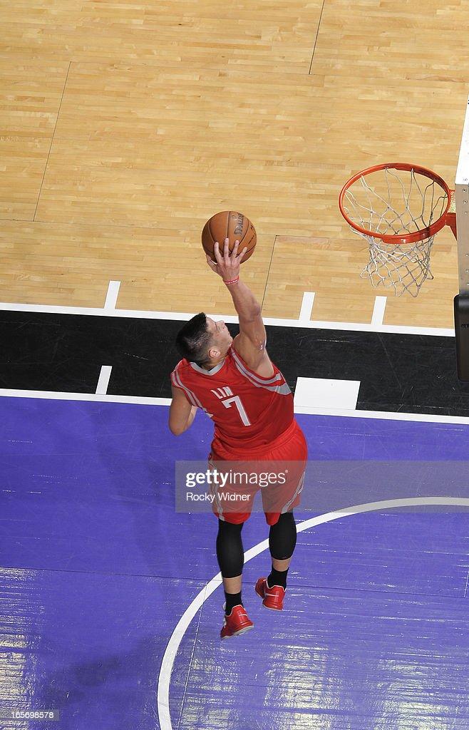 Jeremy Lin #7 of the Houston Rockets dunks against the Sacramento Kings on April 3, 2013 at Sleep Train Arena in Sacramento, California.