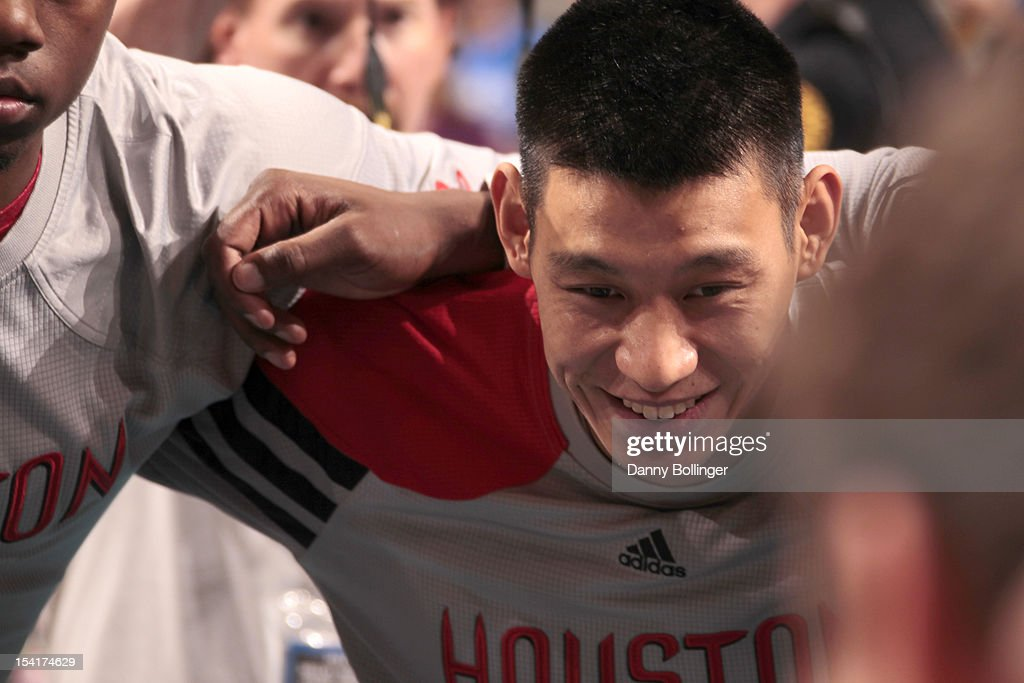 Jeremy Lin #7 of the Houston Rockets in a huddle prior to a game against the Dallas Mavericks on October 15, 2012 at the American Airlines Center in Dallas, Texas.